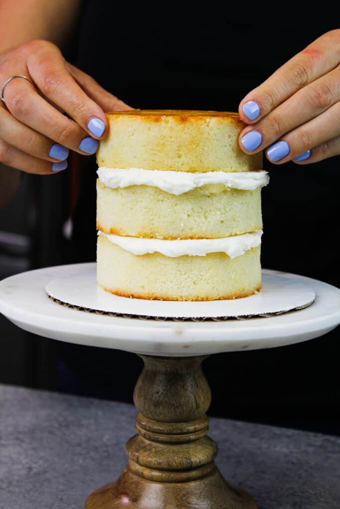 image of 4 inch cake layers being stacked to make a mini smash layer cake