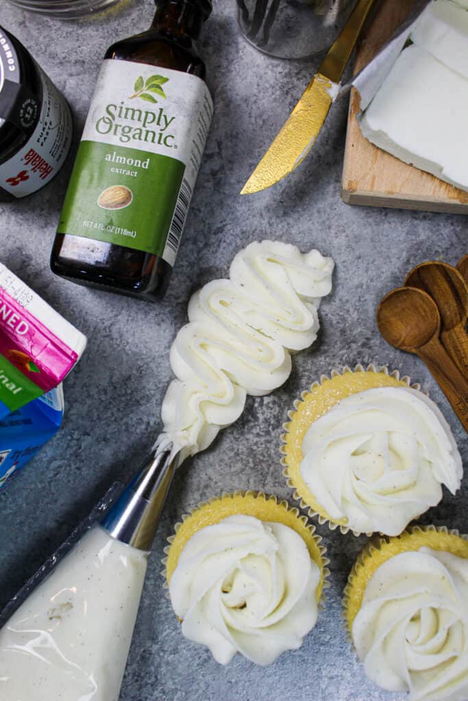image of vegan frosting ingredients laid out around a squiggle of piped frosting to show how smooth it is