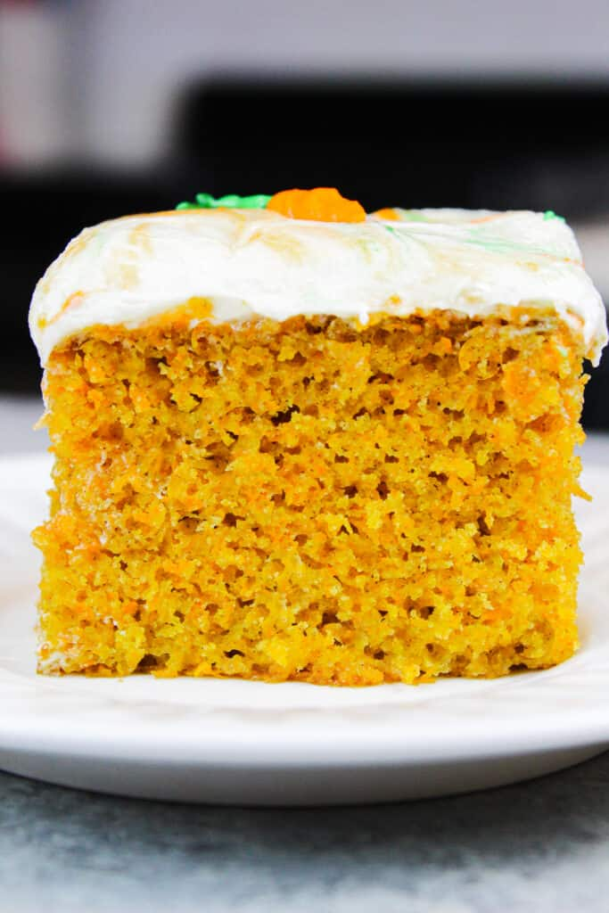 image of carrot cake sheet cake slice on a plate