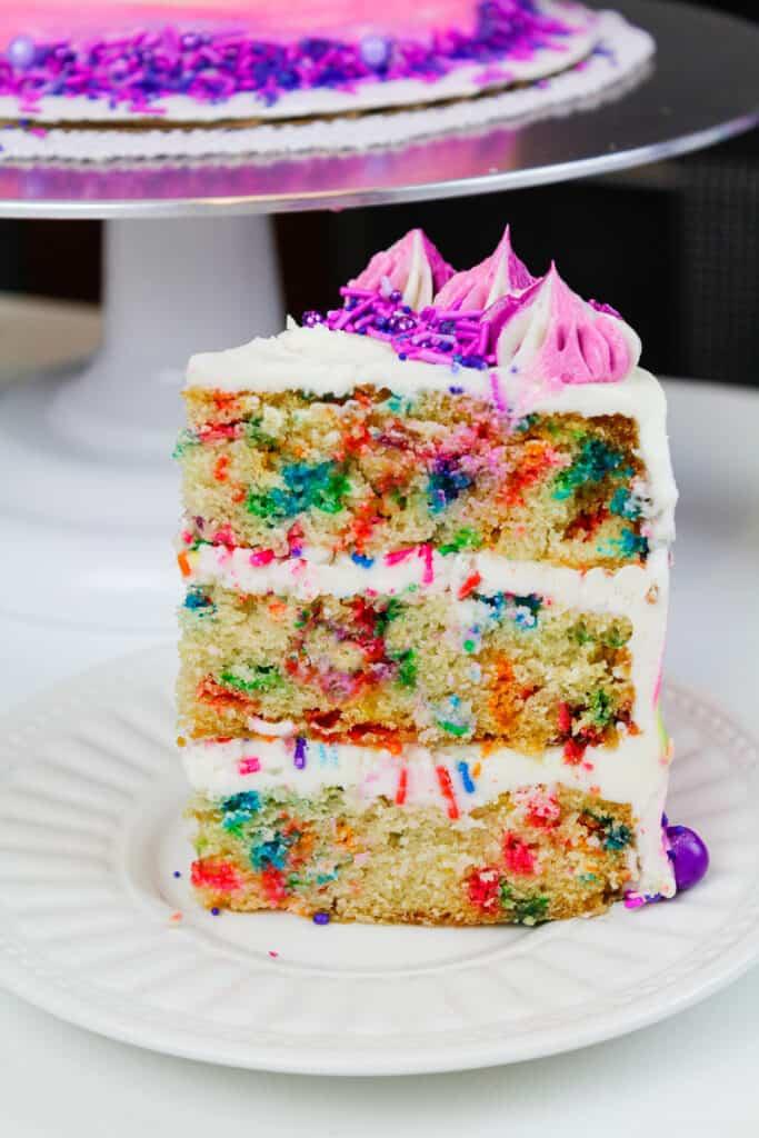 image of a slice of vegan funfetti cake