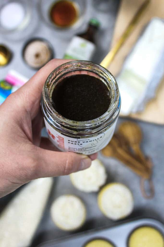 image of vanilla bean paste about to be used in vegan buttercream frosting recipe