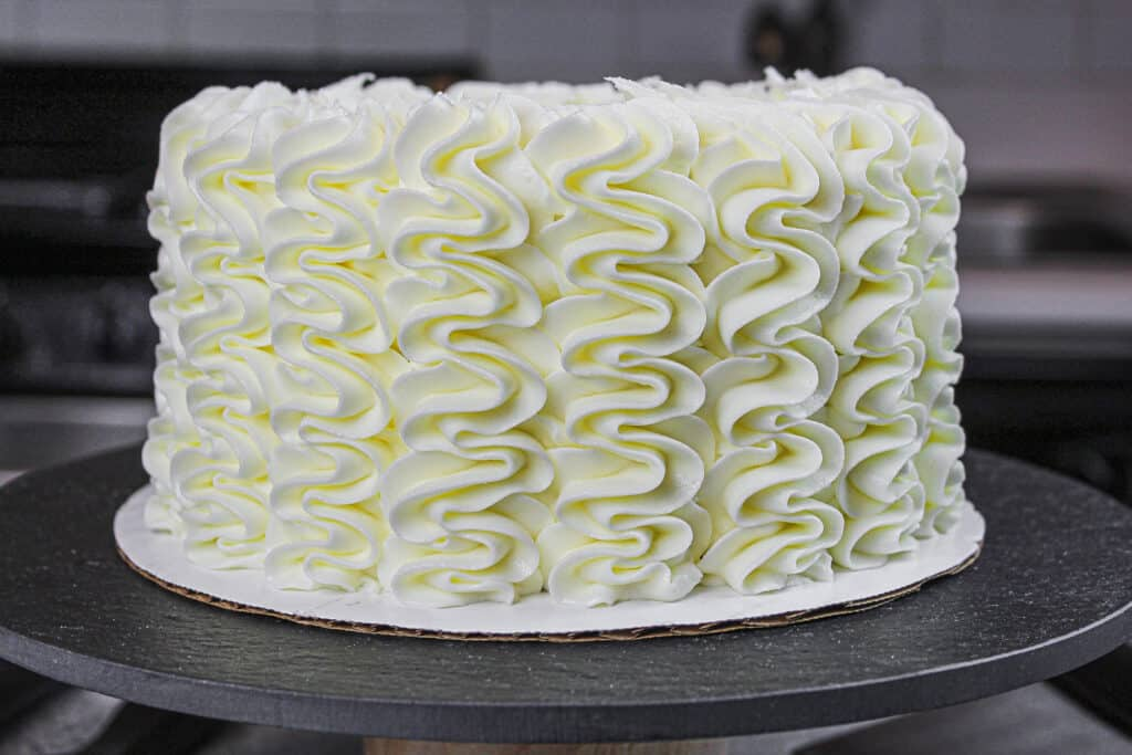image of gluten free layer cake  frosted with a wilton 1M frosting tip