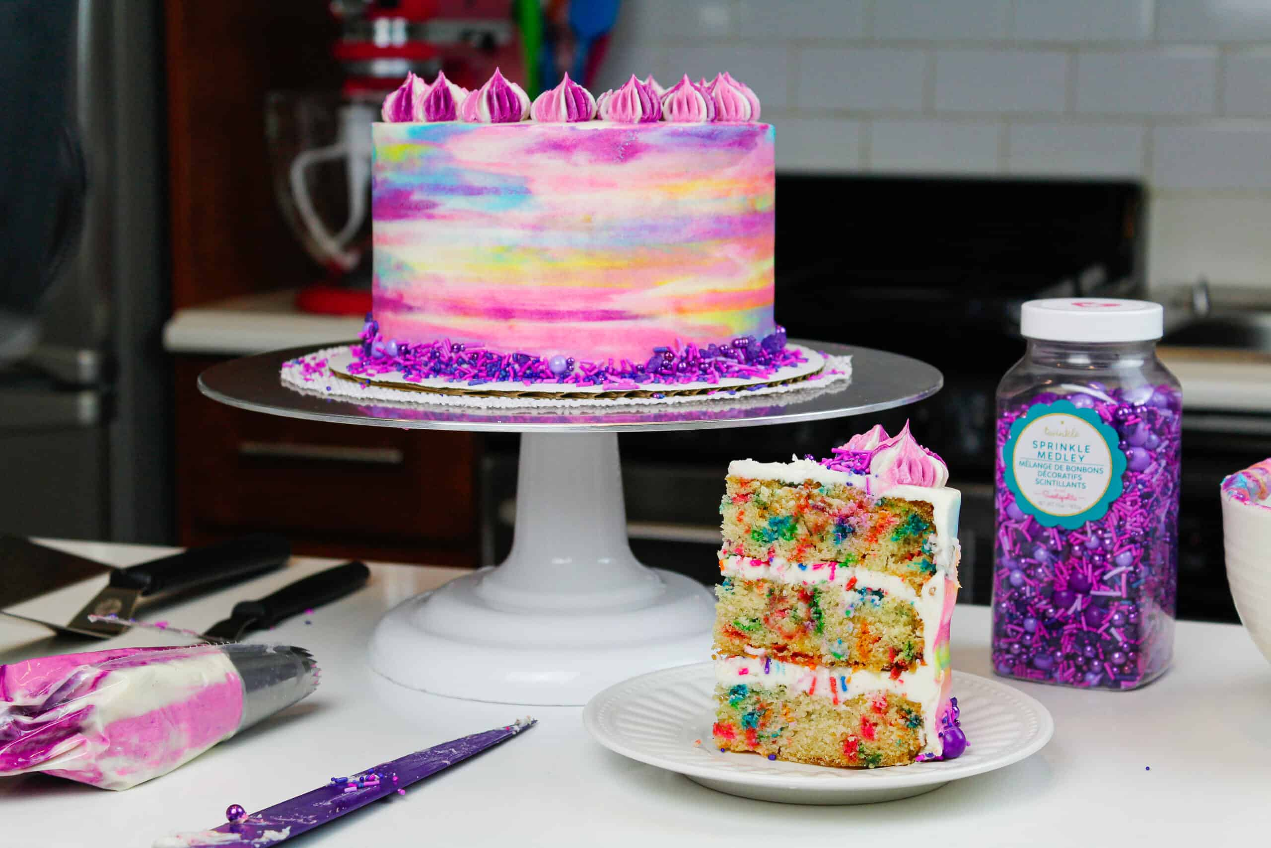 image of vegan confetti cake slice and frosted cake for a birthday