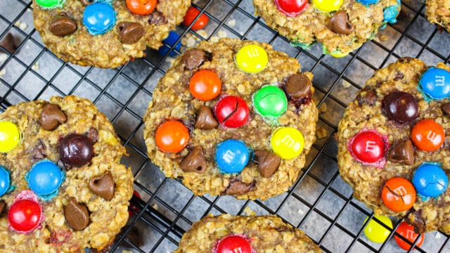 image of gluten free monster cookies cooling on a wire rack