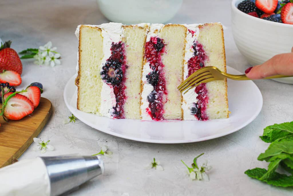 image of slice of berry chantilly cake made with Domino Sugar Golden Sugar