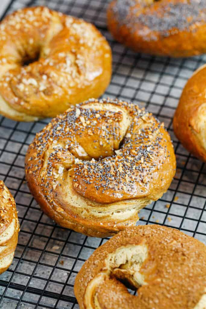 image of homemade bagels cooling on a wire rack