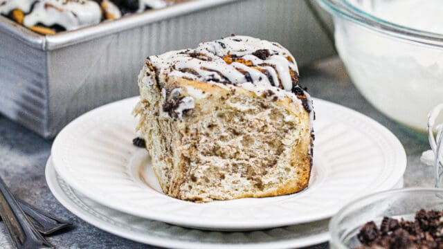 image of cinnamon roll with dark chocolate oreo filling baked and on plate ready to be eaten