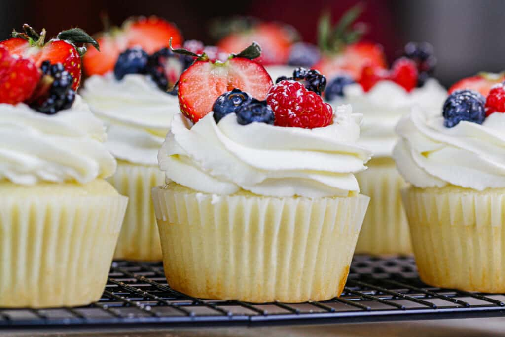 image of cupcakes topped with mascarpone cream frosting and fresh fruit