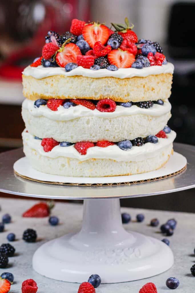 image of a layered angel food cake decorated with fresh berries
