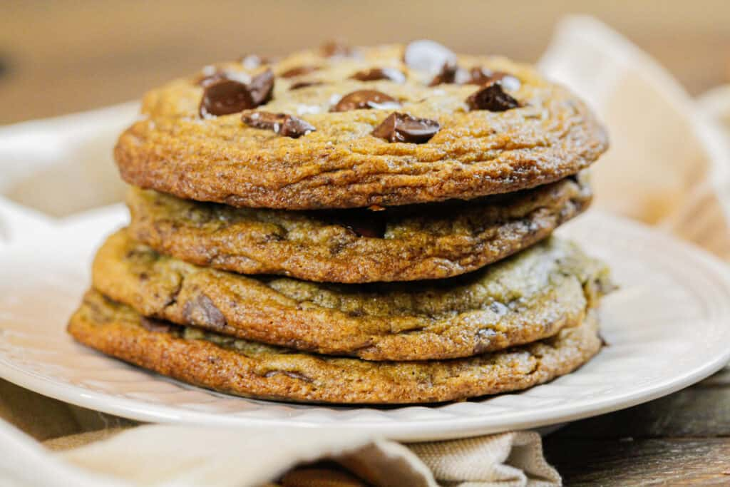 image of stack of brown butter nutella stuffed chocolate chip cookies with golden brown crispy edges