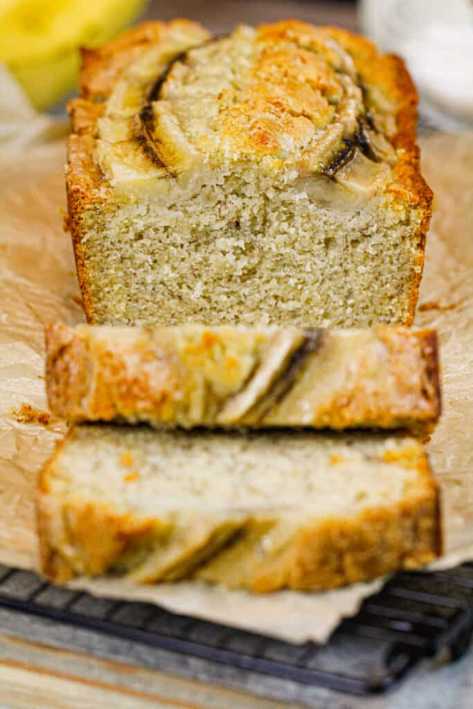 image of moist classic banana bread, sliced and ready to be eaten