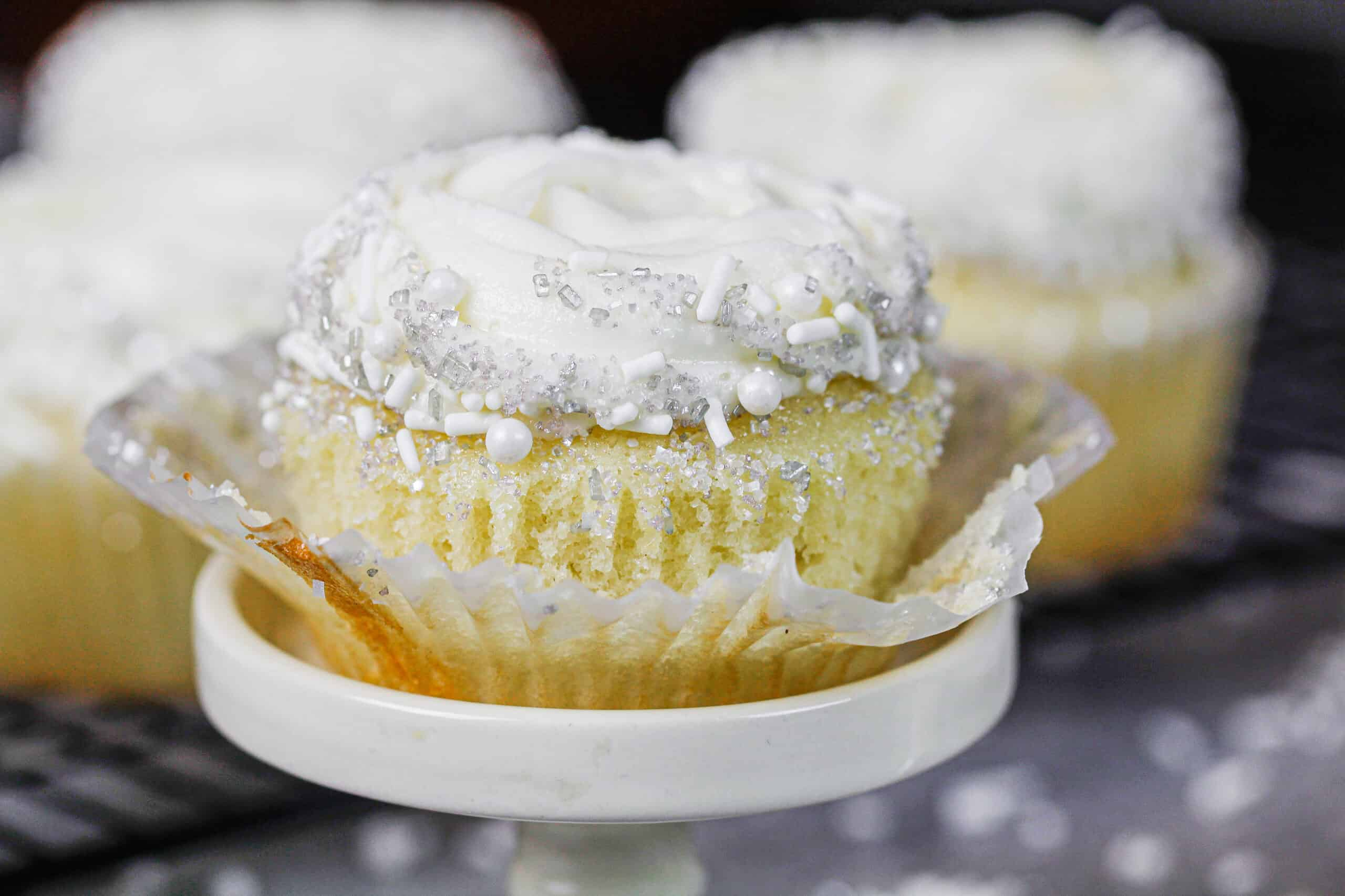 image of pretty almond cupcake unwrapped and ready to be eaten