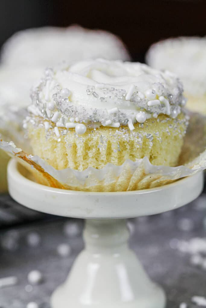 image of almond cupcake unwrapped and ready to be eaten
