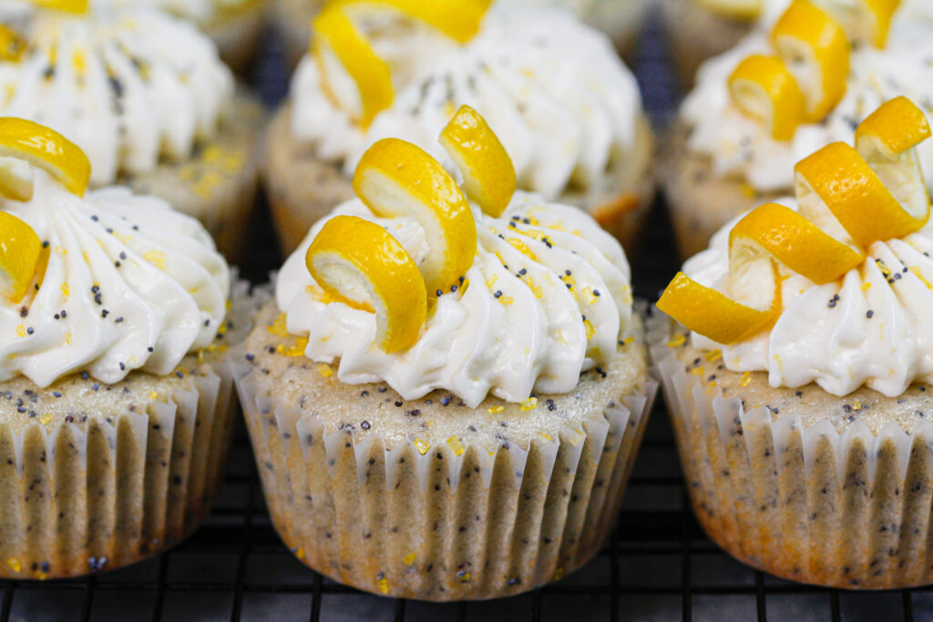 image of lemon poppy seed cupcakes decorated with lemon spirals