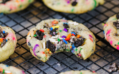 image of funfetti oreo cookie that's been bitten into to show how soft and chewy it is