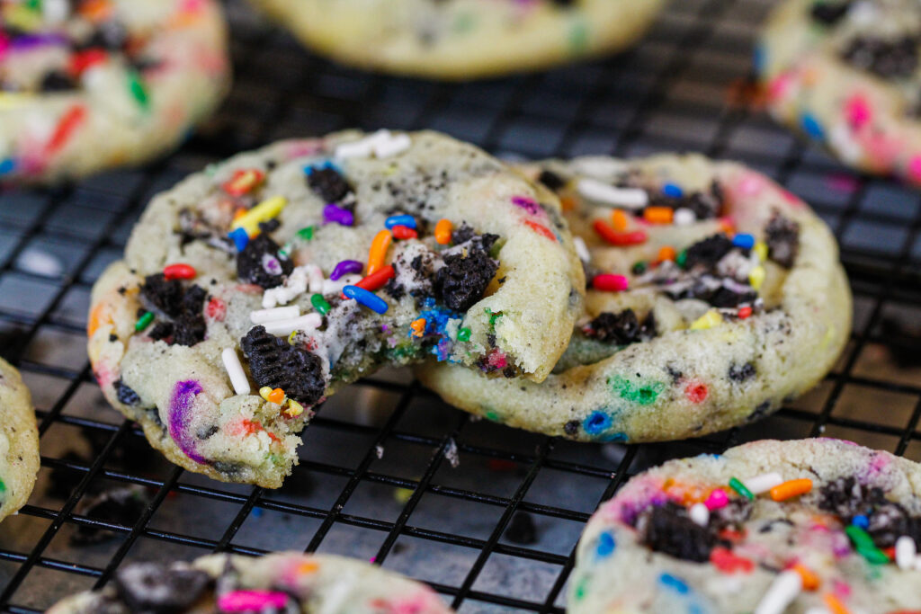 image of funfetti oreo cookies being eaten while they're still warm and fresh out of the oven