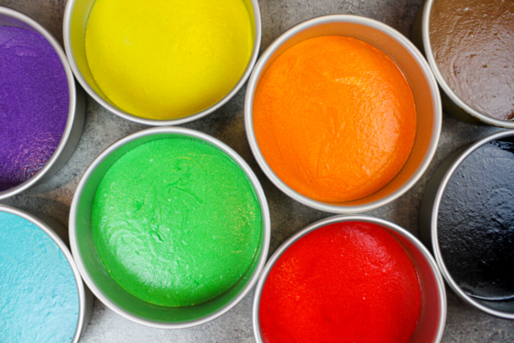 image of rainbow cake layers ready to be baked