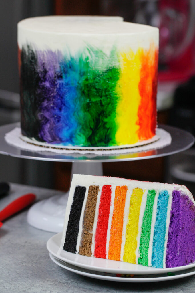 image of rainbow pride cake cut open to show 8 rainbow layers