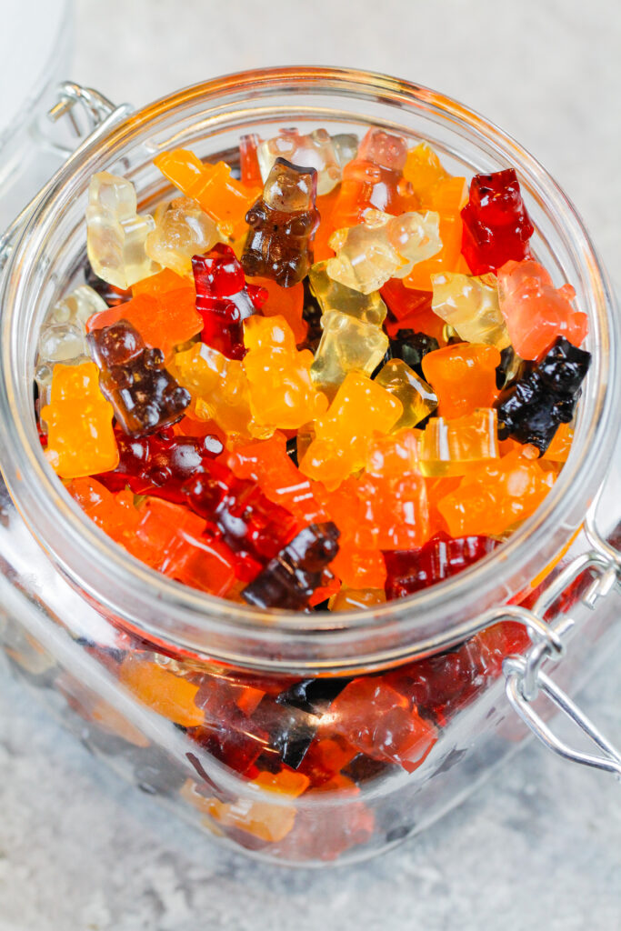 image of homemade healthy gummies stored in an airtight glass container