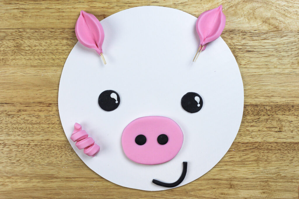 image of fondant pig face ready to be added to a cake
