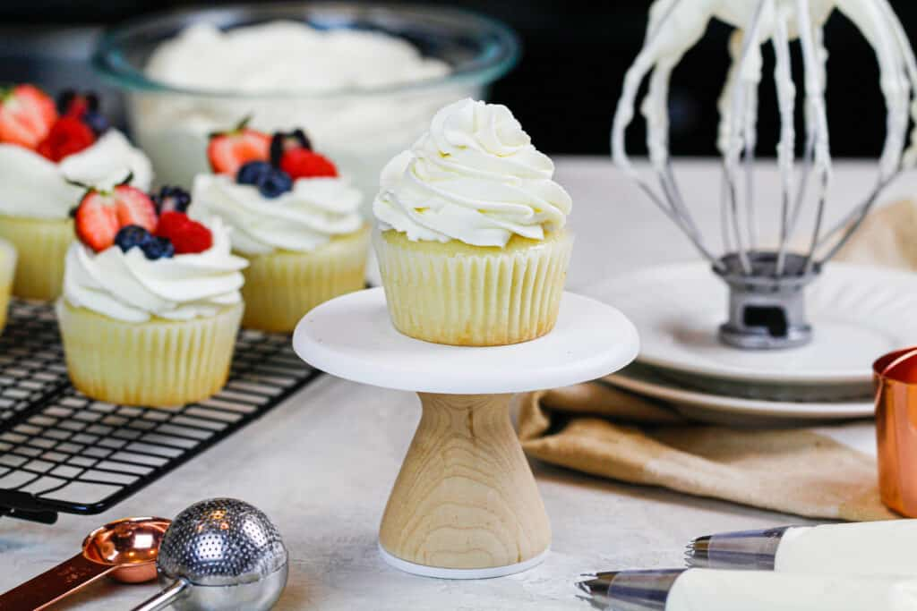image of cupcake frosted with whipped cream frosting with mascarpone cheese
