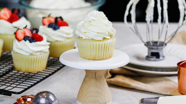 image of cupcake frosted with whipped cream frosting with cream cheese