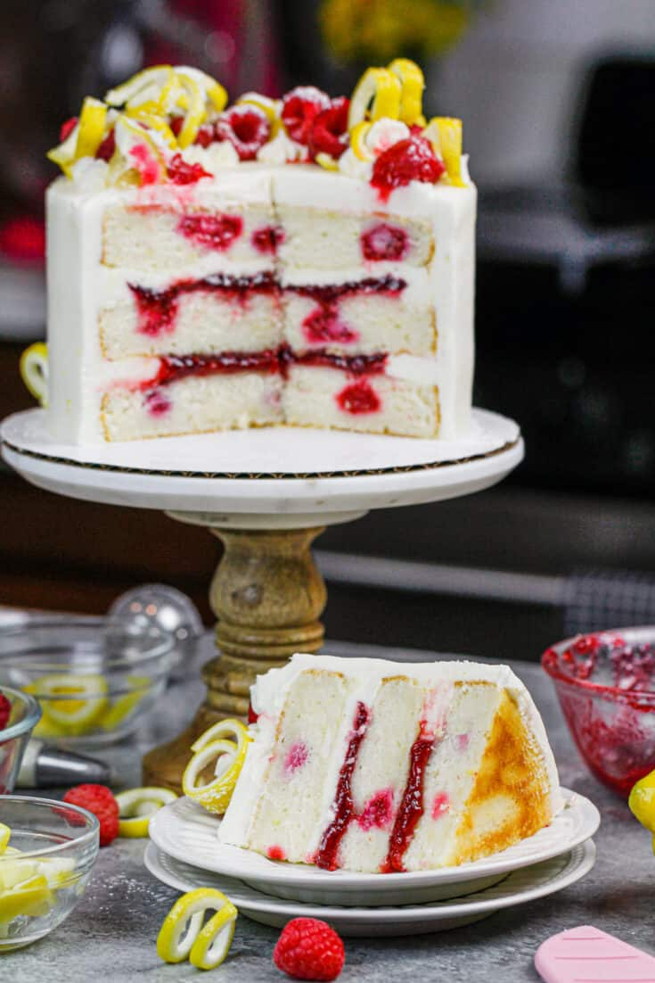 image of lemon raspberry cake slices open to show lemon cream cheese frosting and raspberry filling