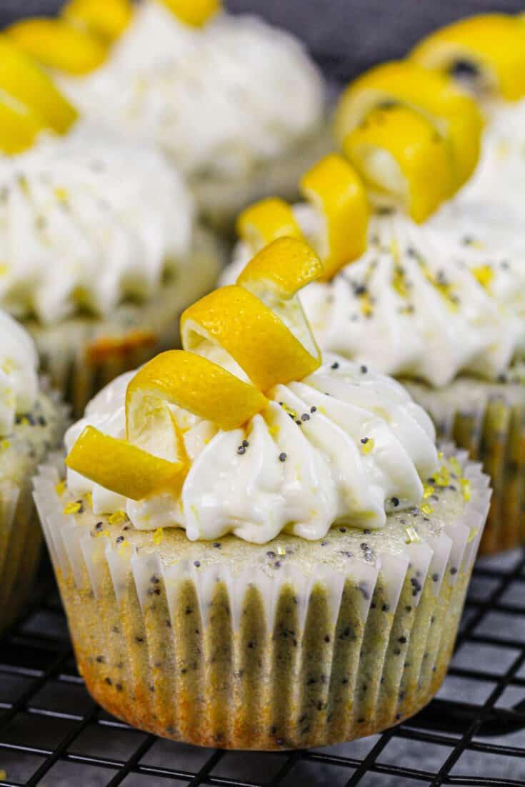 image of lemon poppy seed cupcakes decorated with lemon peel swirls