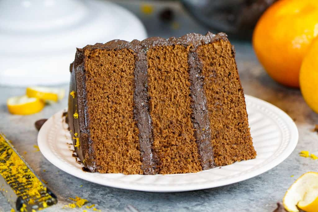 image of a plated slice of orange chocolate cake