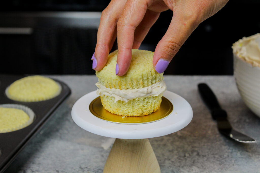 image of cupcake that's been cut in half to make a mini cupcake cake for these dumpling cupcakes