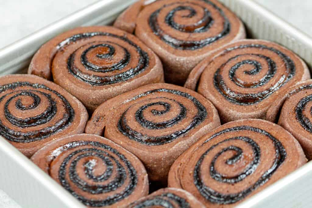 image of proofed chocolate cinnamon rolls ready to be baked