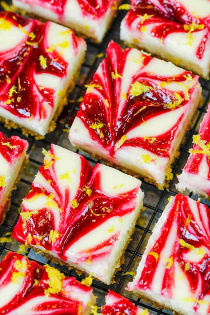 image of raspberry lemon cheesecake cut into squares