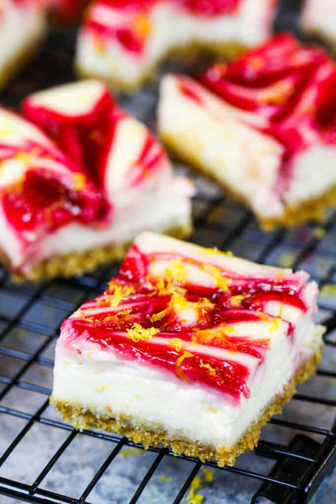 image of lemon cheesecake squares with a raspberry swirl