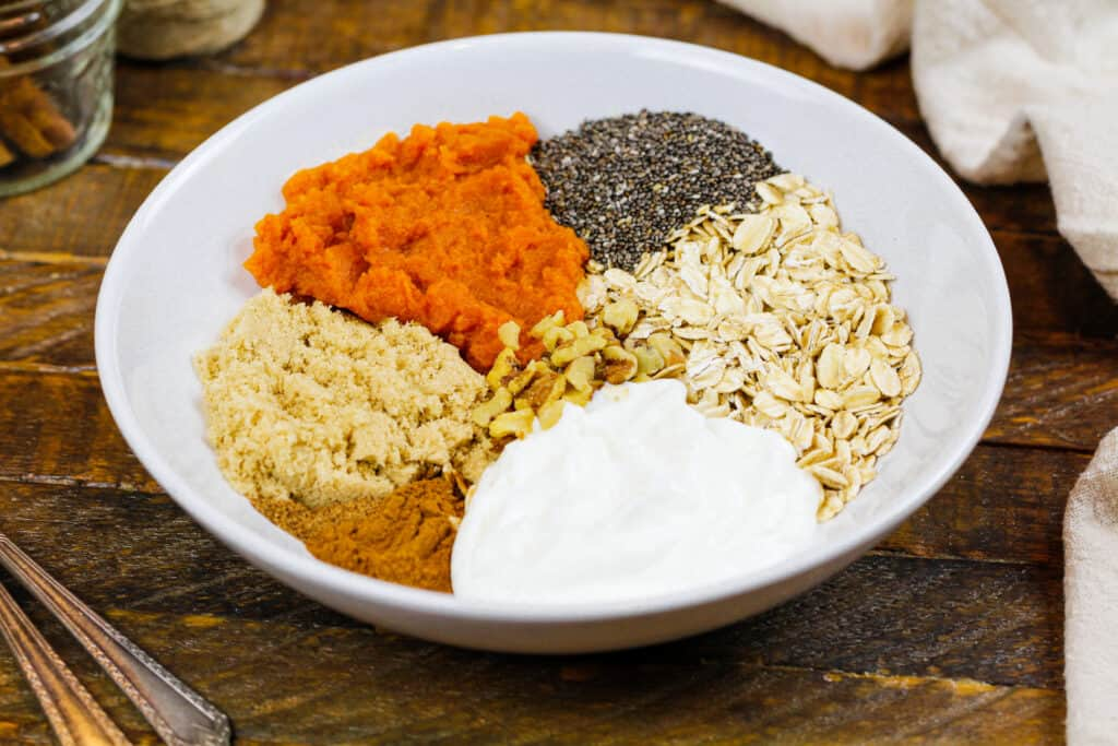 image of ingredients in a bowl ready to make pumpkin spice overnight oats
