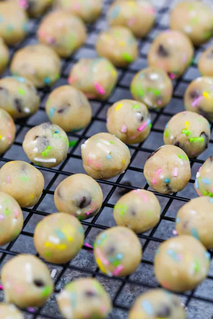 image of vegan edible cookie dough rolled out into small bites sized balls