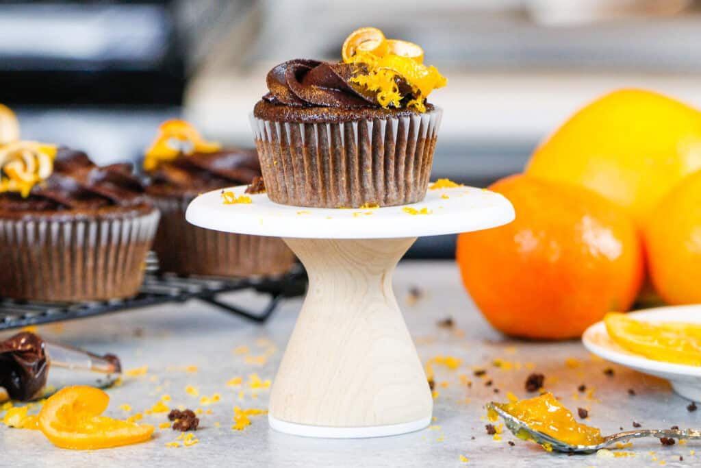 image of a chocolate orange cupcake decorated with chocolate orange buttercream frosting