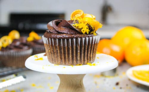 image of an orange chocolate cupcake decorated with chocolate orange buttercream frosting