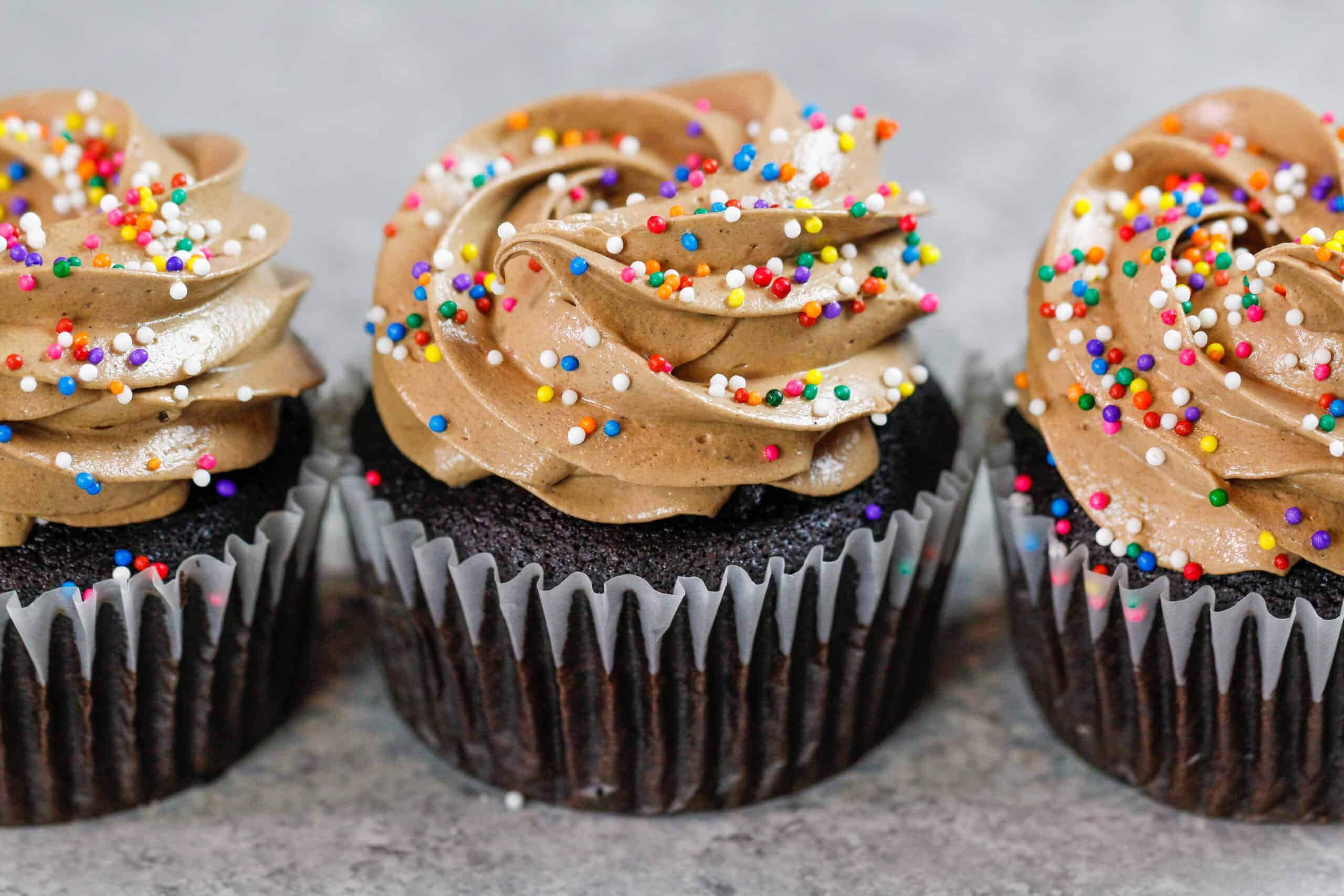 image of chocolate italian meringue buttercream frosted on top of chocolate cupcakes