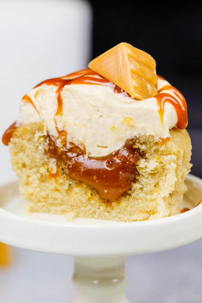 image of a caramel cupcake that's been cut in half to show it's gooey caramel filling