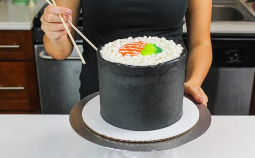 image of a sushi roll cake made with fluffy vanilla cake layers