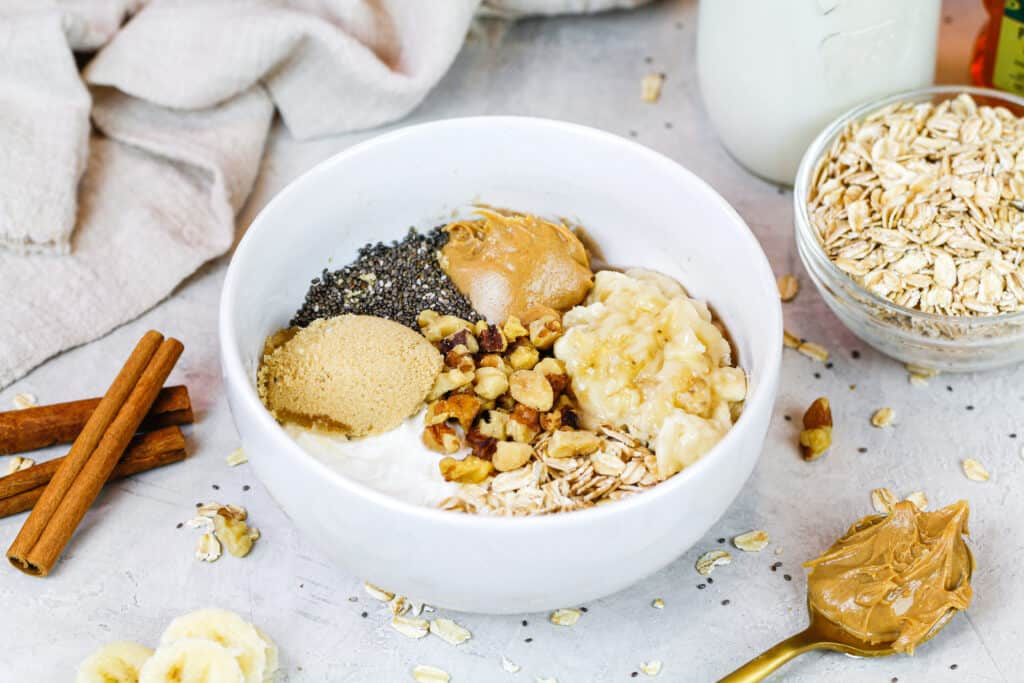 image of ingredients in a bowl ready to make a batch of banana overnight oats