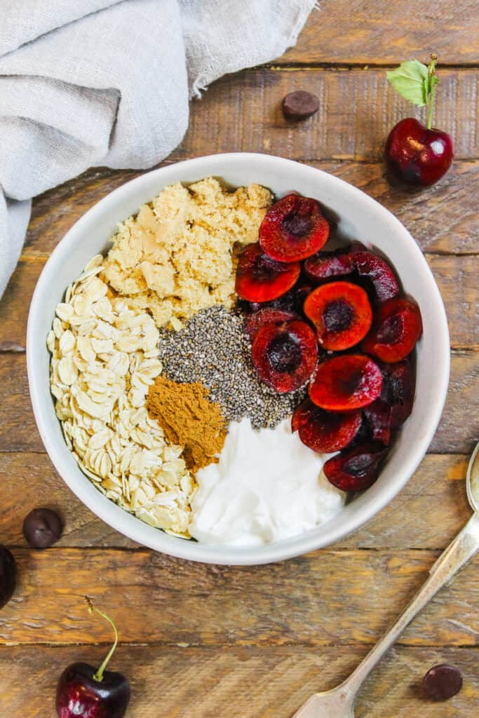 image of ingredients in a bowl to make cherry pie overnight oats
