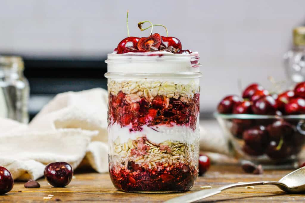 image of overnight oats with cherries in a mason jar
