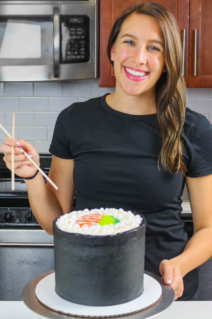 image of a sushi roll cake made for a birthday