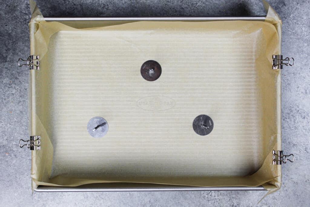 image of a sheet pan prepared to bake a cake