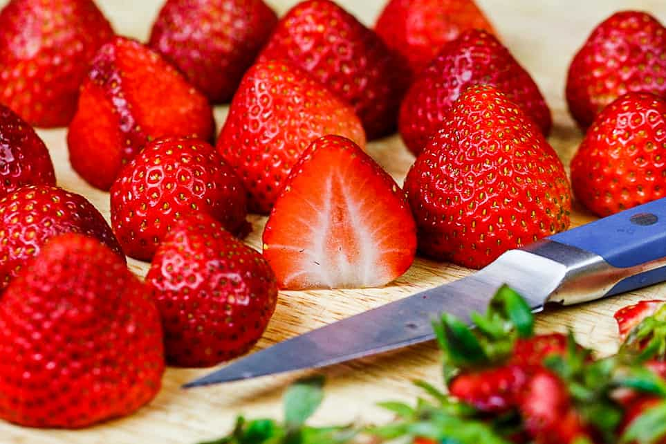 image of strawberries cut and ready to be made into strawberry jam
