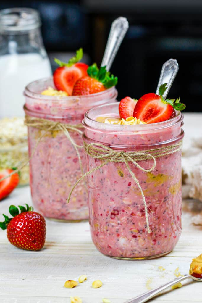 image of peanut butter and jelly overnight oats made in cute mason jars