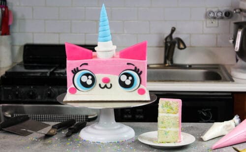 image of unikitty cake made with funfetti cake layers