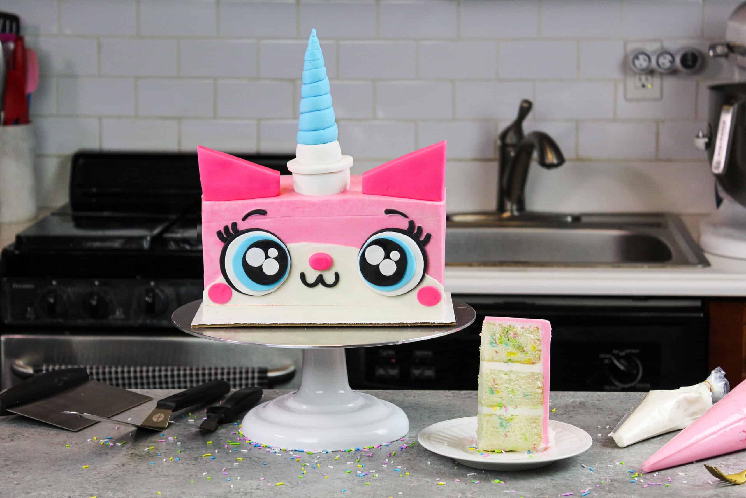 image of unikitty cake made with funfetti cake layers