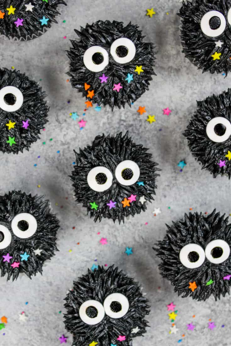 image of soot sprite cupcakes made with black cocoa frosting and candy sprinkle eyes